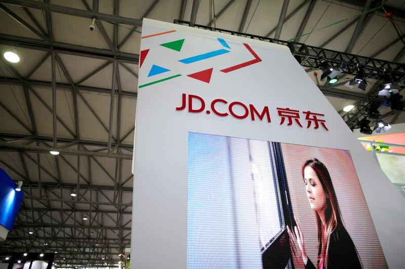 FILE PHOTO: A sign of China's e-commerce company JD.com is seen at CES Asia 2016 in Shanghai