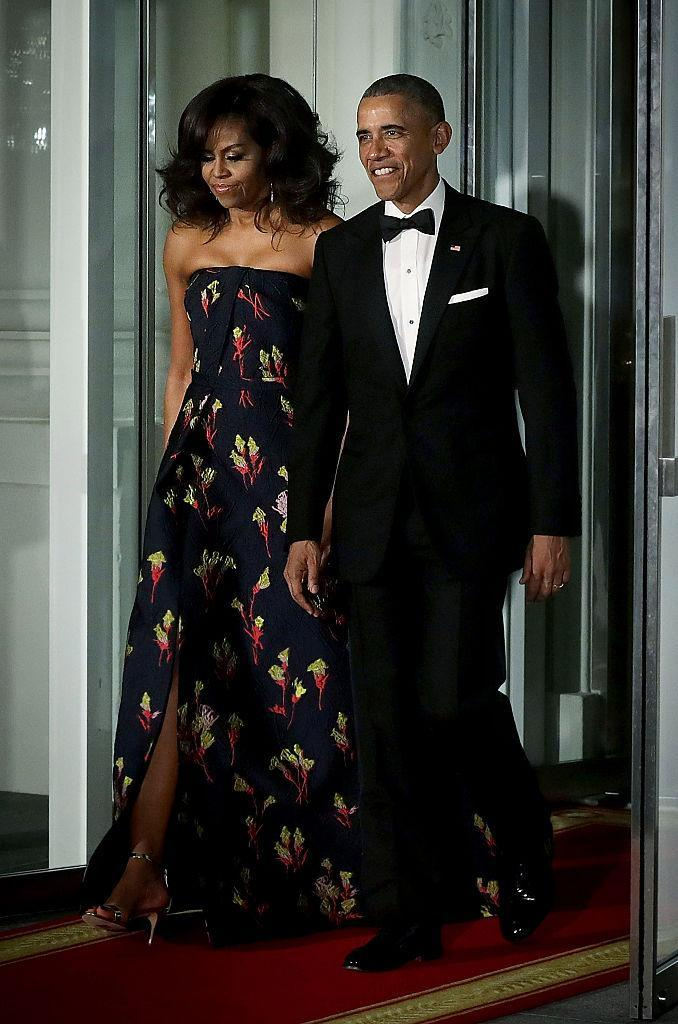 The First Lady wore a blue Wu gown with a playful floral print to the White House dinner for Canadian Prime Minister Justin Trudeau. (Photo: Getty)