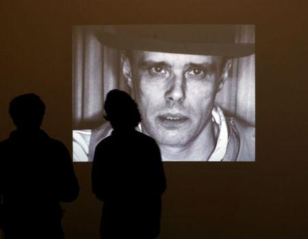 FILE PHOTO: Visitors stand in front of the screen projecting videos of artist Joseph Beuys the The Hamburger Bahnhof museum  in Berlin