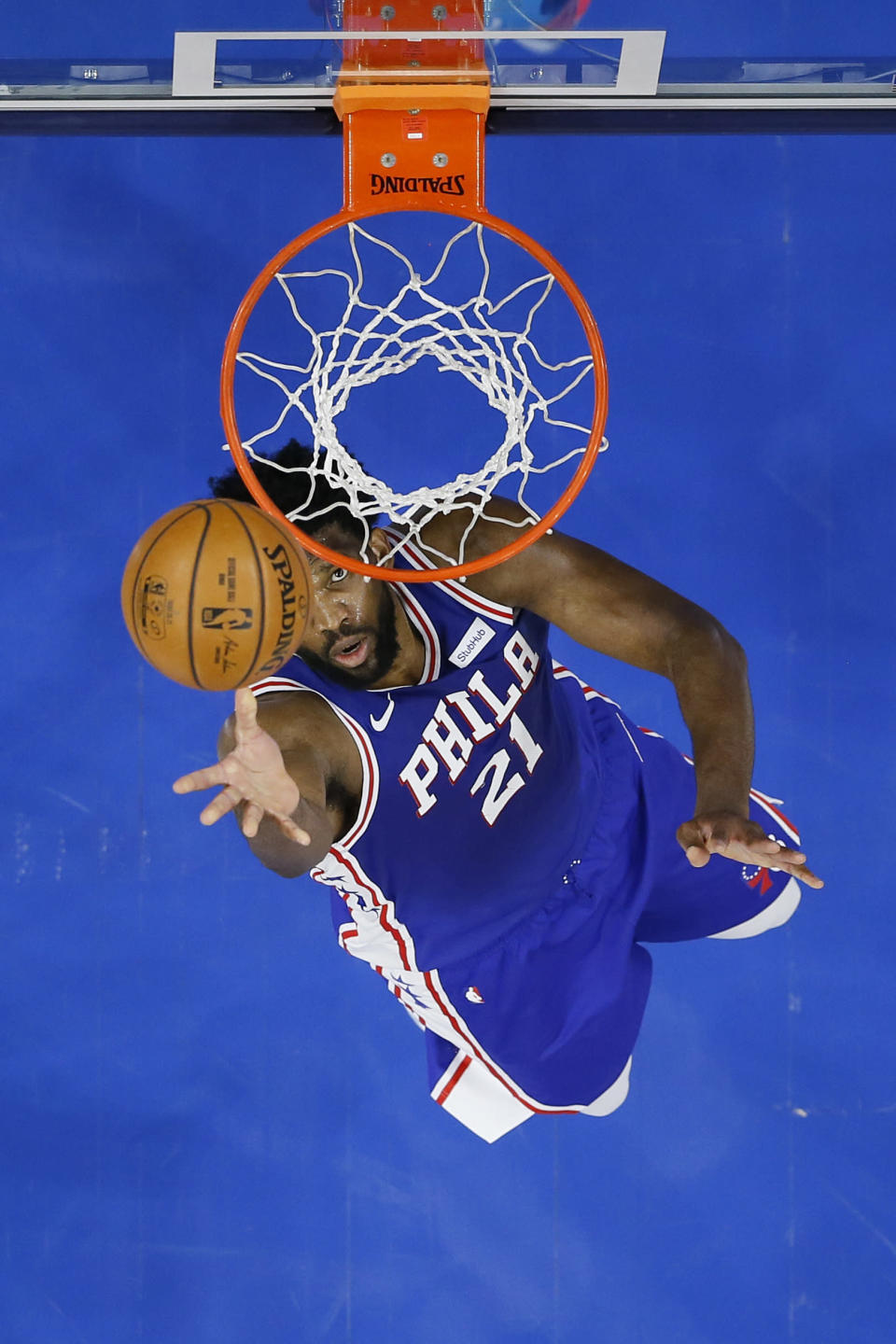 FILE - In this Feb. 4, 2021, file photo, Philadelphia 76ers' Joel Embiid goes up for a shot during the first half of an NBA basketball game against the Portland Trail Blazers in Philadelphia. Embiid is having the best season for a 76ers big man since Moses Malone and he has his team atop the Eastern Conference standings headed into the second half of the season. (AP Photo/Matt Slocum, File)