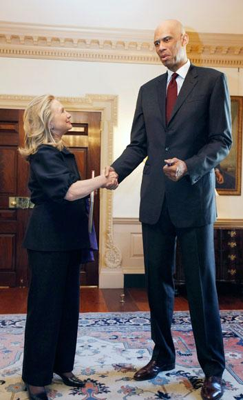 "U.S. Secretary of State Hillary Clinton (L) meets with Cultural Ambassador Kareem Abdul Jabbar at the State Department January 18, 2012 in Washington, DC. According to the State Department, Jabbar, a National Basketball Association superstar and hall of fame player, ""will lead conversations with young people on the importance of education, social and racial tolerance, cultural understanding, and using sports as a means of empowerment.""  (Photo by Chip Somodevilla/Getty Images)"