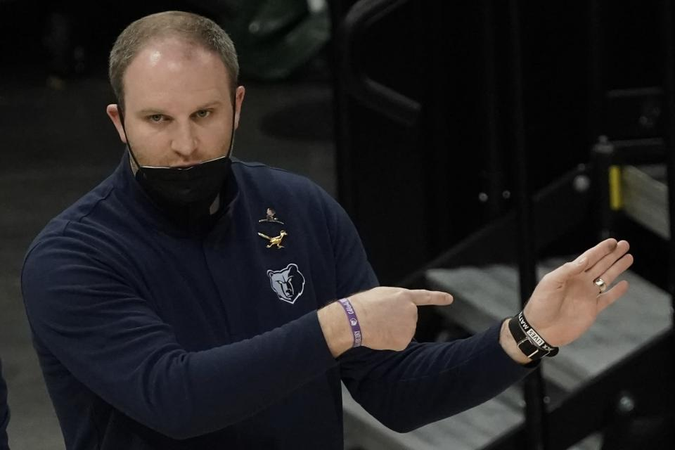 Memphis Grizzlies head coach Taylor Jenkins signals to his players during the first half of an NBA basketball game against the Milwaukee Bucks Saturday, April 17, 2021, in Milwaukee. (AP Photo/Morry Gash)