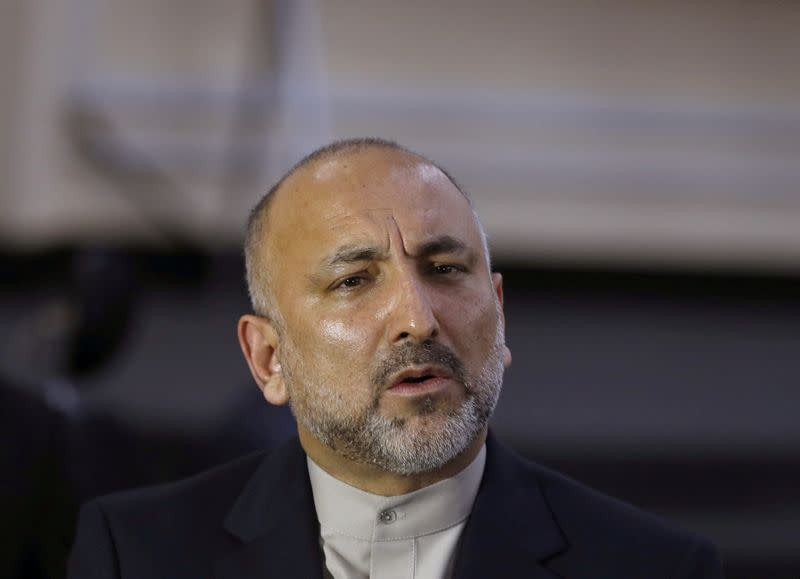 FILE PHOTO: Mohammad Hanif Atmar, former Afghanistan National Security Adviser, speaks to the media after arriving to register as a candidate for the presidential election at Afghanistan's Independent Election Commission in Kabul