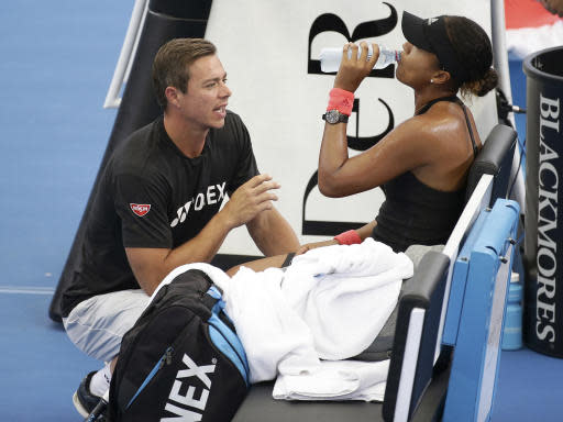 """File- This Jan. 5, 2019, file photo shows Naomi Osaka of Japan talking to her coach Sascha Bajin, left, during her semifinal match against Lesia Tsurenko of Ukraine at the Brisbane International tennis tournament in Brisbane, Australia. Osaka says she has split with coach Sascha Bajin a little more than two weeks after winning the Australian Open for her second consecutive Grand Slam title. Osaka posted a tweet on Monday, Feb. 11, 2019, that says she """"will no longer be working together with Sascha."""" She also thanked Bajin and wished him """"all the best in the future."""" (AP Photo/Tertius Pickard)"""