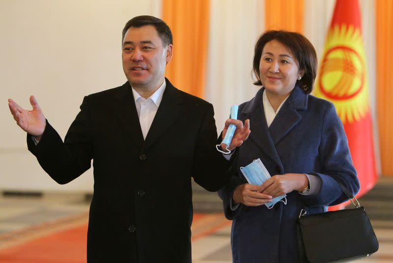 Presidential candidate Sadyr Japarov and his wife Aigul pose for a picture during a presidential election and constitutional referendum in Bishkek