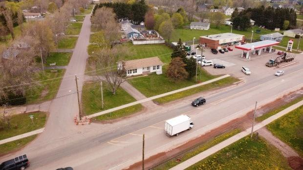 This intersection could not safely be replaced with a roundabout with the entrance to Mel's Convenience where it is, says the province. (Shane Hennessey/CBC - image credit)