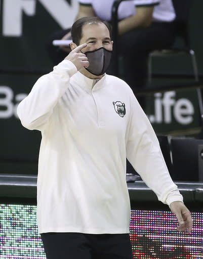 Baylor head coach Scott Drew gestures to his team in the first half of an NCAA college basketball game against Central Arkansas, Tuesday, Dec. 29, 2020, in Waco, Texas. (AP Photo/ Jerry Larson)