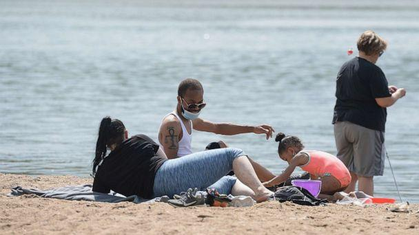 PHOTO: A family spends Memorial Day relaxing on a beach front at Creve Coeur Lake Park on May 25, 2020 in Maryland Heights, Missouri. (Michael Thomas/Getty Images)