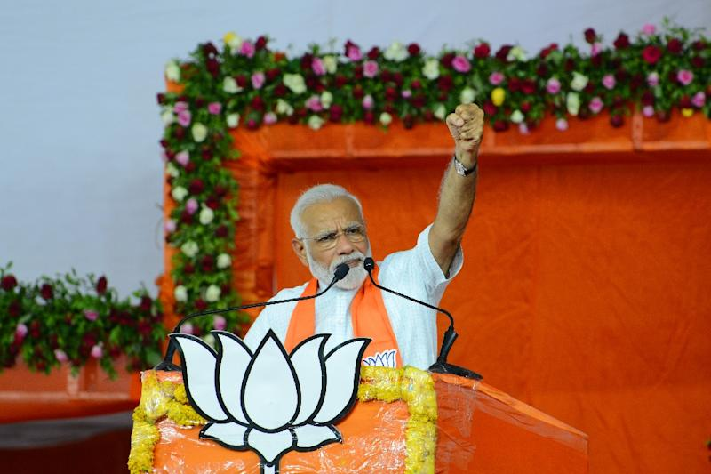 Indian Prime Minister Narendra Modi raises his fist as he salutes a crowd of supporters at a Sunday rally in Ahmedabad, in the western state of Gujarat