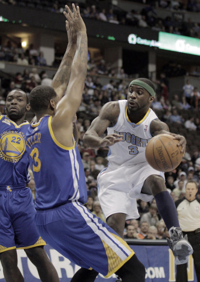 Denver Nuggets' Ty Lawson (3) passes around Golden State Warriors' Jeremy Tyler, left, in the first period of their NBA game in Denver on Monday, April 9, 2012.(AP Photo/Joe Mahoney)