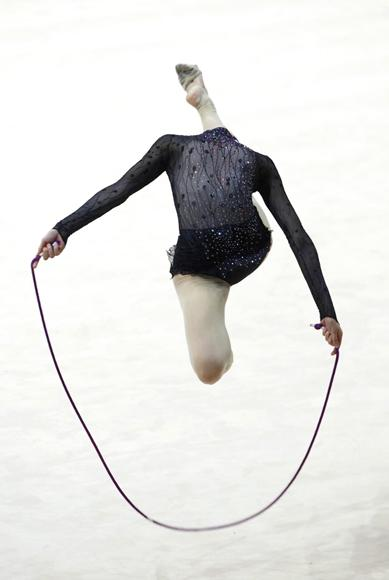 Bulgaria's Bilyana Prodanova performs her routine with the rope during the rhythmic gymnastics qualifying round at the 2009 World Games in Kaohsiung July 17, 2009. The World Games will be held from July 16-26 in the southern Taiwan city of Kaohsiung. (REUTERS/Nicky Loh)