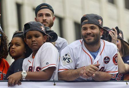 FILE PHOTO: Nov 3, 2017; Houston, TX, USA; Houston Astros  second baseman Jose Altuve (27) greets fans during the World Series championship parade and rally for the Houston Astros in downtown on Smith St. Thomas B. Shea-USA TODAY Sports