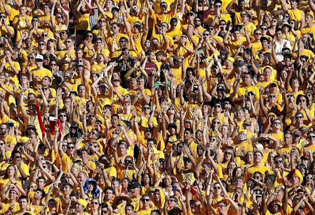 Arizona State fans cheer during the first half of an NCAA college football game against Washington, Saturday, Oct. 19, 2013, in Tempe, Ariz. (AP Photo/Matt York)