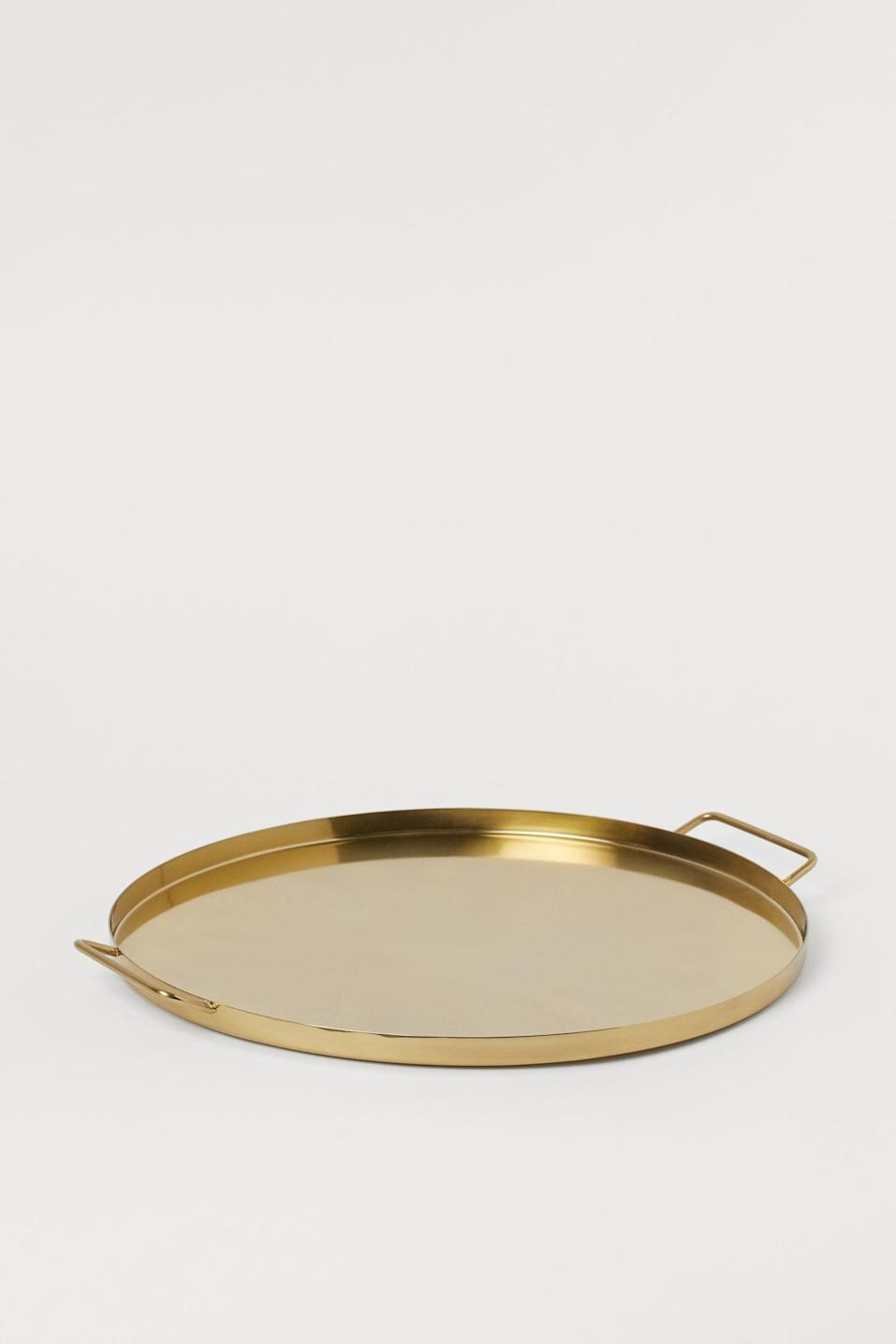 <p>Add this glam <span>H&amp;M Round Metal Tray</span> ($25) to their barware. </p>