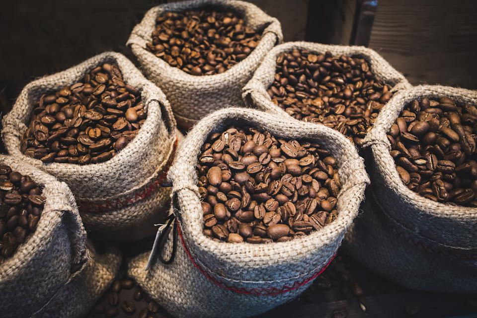 Coffee beans in bags. Fresh coffee beans background. Source: Getty Images