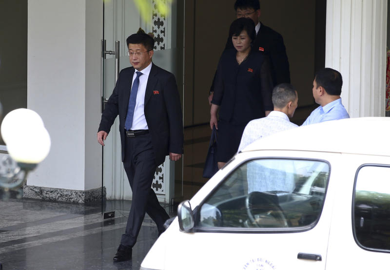 FILE - In this Feb. 21, 2019, file photo, Kim Hyok Chol, left, North Korea's special representative for U.S. affairs, leaves the Government Guest House in Hanoi, Vietnam. A South Korean newspaper is reporting that North Korea executed a senior envoy involved in nuclear negotiations with the U.S. as well as four other high-level officials. (AP Photo, File)