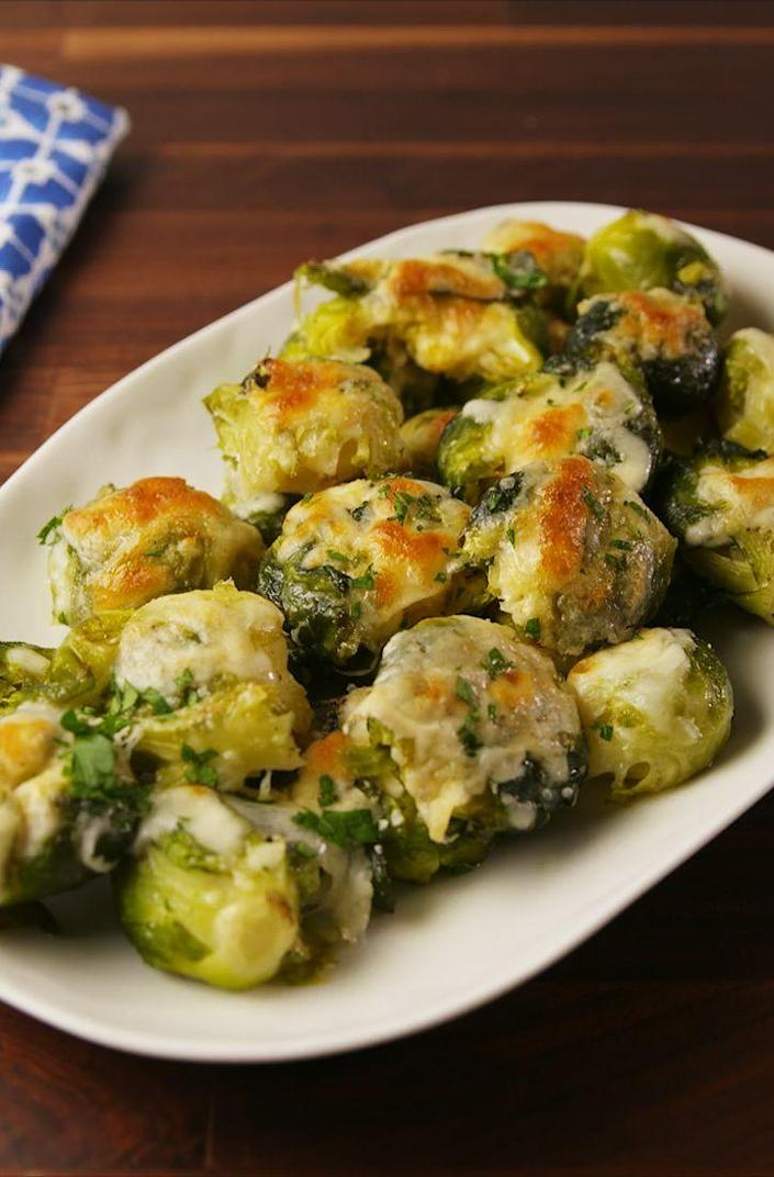 """<p>Smashed and cheesy means you can't go wrong.</p><p>Get the recipe from <a href=""""https://www.delish.com/cooking/recipe-ideas/recipes/a57237/smashed-brussels-sprouts-recipe/"""" rel=""""nofollow noopener"""" target=""""_blank"""" data-ylk=""""slk:Delish"""" class=""""link rapid-noclick-resp"""">Delish</a>.</p><p><strong><a class=""""link rapid-noclick-resp"""" href=""""https://go.redirectingat.com?id=74968X1596630&url=https%3A%2F%2Fwww.barnesandnoble.com%2Fw%2Fdelish-editors-of-delish%2F1127659306%3Fst%3DAFF%26SID%3DBarnes%2B%2526%2BNoble%2B-%2BTop%2B100%253A%2BBook%2BBestsellers%262sid%3DSkimlinks_7689440_NA&sref=https%3A%2F%2Fwww.delish.com%2Fholiday-recipes%2Fchristmas%2Fg1421%2Fchristmas-side-dishes%2F"""" rel=""""nofollow noopener"""" target=""""_blank"""" data-ylk=""""slk:GET YOURS NOW"""">GET YOURS NOW</a><em> Delish Cookbook, </em><em>barnesandnoble.com</em> </strong></p>"""