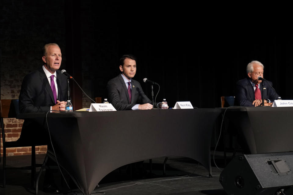 Republican gubernatorial candidate, Kevin Faulconer, left, answers a question during a debate with challengers Assemblyman Kevin Kiley, R-Rocklin, center, and businessman John Cox, right, held by the Sacramento Press Club in Sacramento, Calif., Tuesday, Aug. 17, 2021. California voters have until Sept. 14 to cast their ballots to either retain Democratic Gov. Gavin Newsom in or to recall him and select one of the more than 40 choices on the ballet. (AP Photo/Rich Pedroncelli)