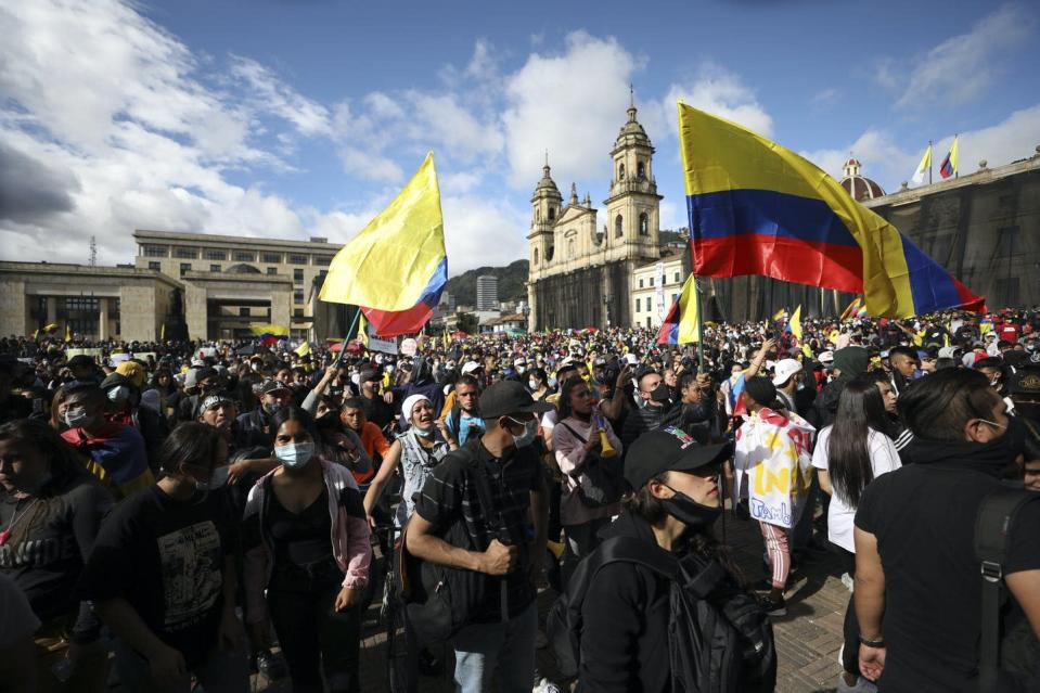 """<span class=""""caption"""">Protesters attend an anti-government march at Plaza Bolivar in Bogota, Colombia, where citizens have taken to the streets for weeks after proposed tax increases and to decry police brutality.</span> <span class=""""attribution""""><span class=""""source"""">(AP Photo/Fernando Vergara) </span></span>"""