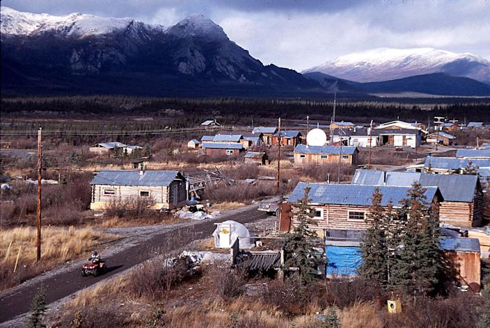 Arctic Village, Alaska, as seen in 1999. Set at the foot of the Brooks Range, about 200 miles north of the Arctic Circle, the village was struck by COVID-19 in 2020 and won a lawsuit that made it easier to cast absentee ballots.