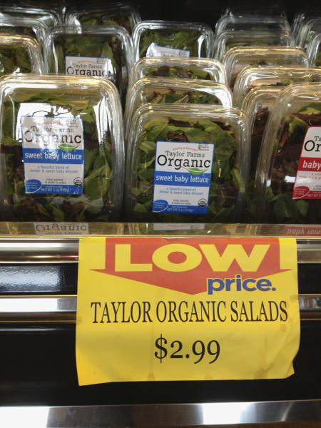 <p> File - In this Aug. 3, 2013, file photo are packages of Taylor Farms salads for sale at a supermarket in Omaha, Neb. Salinas, Calif.-based Taylor Farms announced Monday, Aug. 12, 2013, that Taylor Farms de Mexico has stopped production of salad mix and leafy greens at its facility that have been linked to an outbreak of stomach illnesses in Iowa and Nebraska. Production has been shifted to crops and processing facilities in the United States. (AP Photo/Nati Harnik, File)
