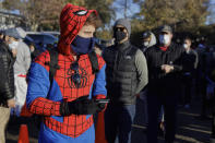 Colin Buckley of Omaha wears a Spiderman suit as he waits to cast an early vote on Halloween, at the Douglas County Election Commission office in Omaha, Neb., Saturday, Oct. 31, 2020. (AP Photo/Nati Harnik)