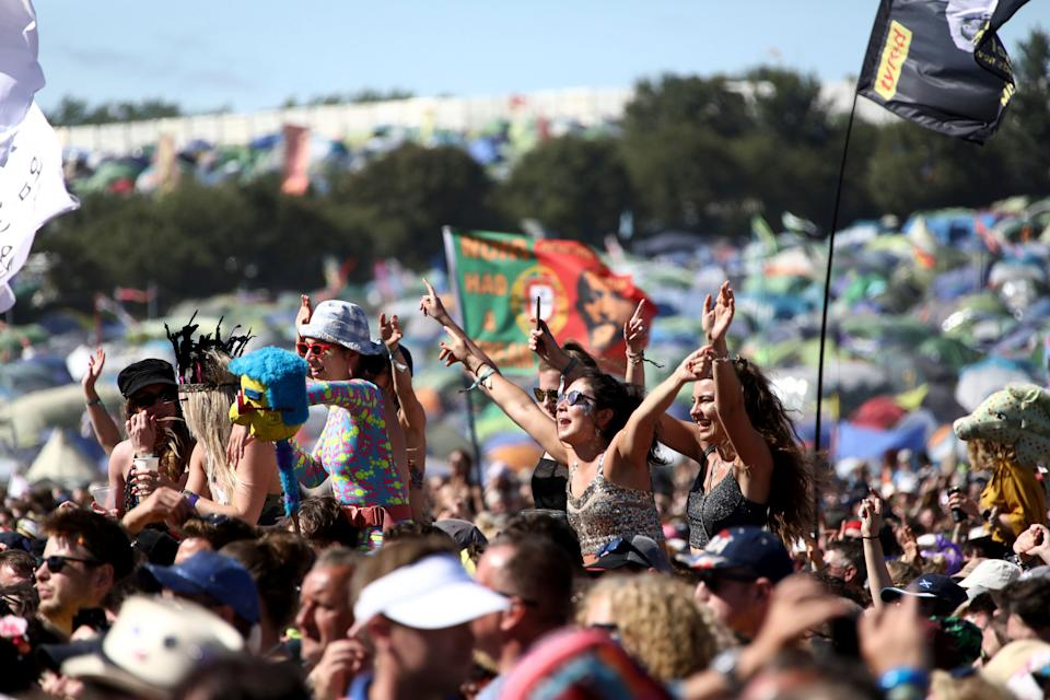 Festival-goers watch Kylie Minogue at the Glastonbury Festival (Photo: Grant Pollard/Invision/AP)