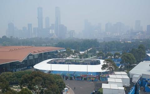 Haze covers the skyline during practice sessions at the Australian Open - Credit: Rex