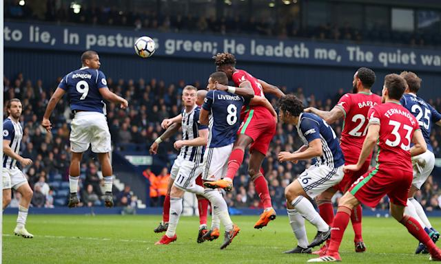 Tammy Abraham rises above the West Brom defence to head in Swansea's equaliser late in the second half.