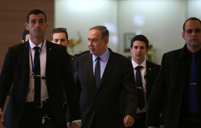 Israeli Prime Minister and Likud party leader Benjamin Netanyahu (C) is surrounded by bodyguards as he arrives for a meeting with party members at the Knesset, the Israeli parliament in Jerusalem, on January 30, 2017
