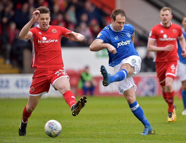 "Soccer Football - League One - Walsall vs Portsmouth - The Banks's Stadium, Walsall, Britain - March 31, 2018 Portsmouth's Brett Pitman in action with Walsall's Jack Fitzwater Action Images/Paul Burrows EDITORIAL USE ONLY. No use with unauthorized audio, video, data, fixture lists, club/league logos or ""live"" services. Online in-match use limited to 75 images, no video emulation. No use in betting, games or single club/league/player publications. Please contact your account representative for further details."