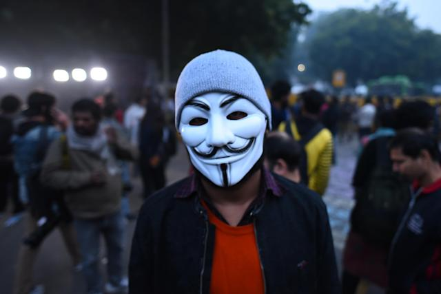 NEW DELHI, INDIA - DECEMBER 19: A demonstrator in an anonymous facemask against the Citizenship Amendment Act (CAA) and National Register of Citizens (NRC) at Jantar Mantar on December 19, 2019 in New Delhi, India. The act seeks to grant Indian citizenship to refugees from Hindu, Christian, Sikh, Buddhist and Parsi communities fleeing religious persecution from Pakistan, Afghanistan, and Bangladesh, and who entered India on or before December 31, 2014. The Parliament had passed the Citizenship (Amendment) Bill, 2019 last week and it became an act after receiving assent from President Ram Nath Kovind. Since then, protests including some violent ones have erupted in various regions of the country, including the North East over the amended citizenship law.(Photo by Sanchit Khanna/Hindustan Times via Getty Images)