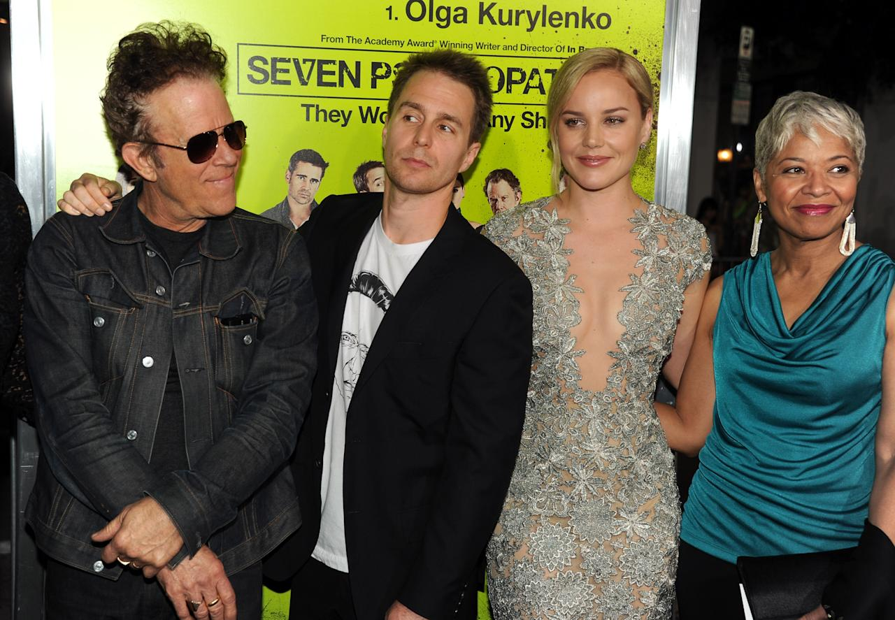 """WESTWOOD, CA - OCTOBER 01:  Actors Tom Waits, Sam Rockwell, Abbie Cornish, and Linda Bright Clay arrive at the premiere of CBS Films' """"Seven Psychopaths"""" at Mann Bruin Theatre on October 1, 2012 in Westwood, California.  (Photo by Kevin Winter/Getty Images)"""