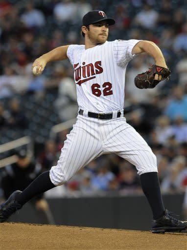 Minnesota Twins pitcher Liam Hendriks throws against the Kansas City Royals in the first inning of a baseball game, Thursday, Sept. 13, 2012 in Minneapolis. (AP Photo/Jim Mone)