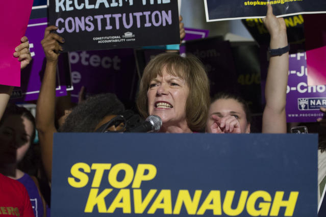 <p>Sen. Tina Smith, D-Minn., speaks in front of the Supreme Court in Washington, Monday, July 9, 2018, after President Donald Trump announced Judge Brett Kavanaugh as his Supreme Court nominee. (Photo: Cliff Owen/AP) </p>