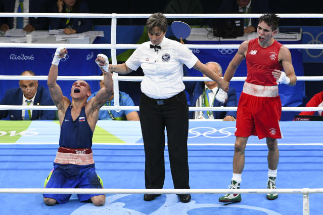 Vladimir Nikitin (L) reacts after he won against John Michael Conlan (R) in the quarterfinals during the Olympic Games in Rio De Janeiro, Brazil. (Photo by Jonathan Newton/The Washington Post via Getty Images)