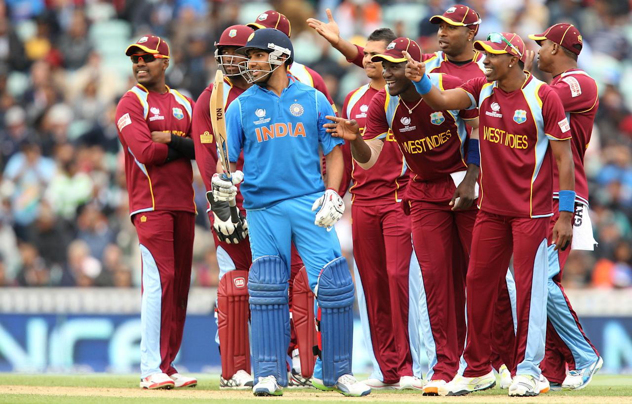 India's Rohit Sharma is taunted by West Indies players before being given out by the video umpire during the ICC Champions Trophy match at the Kia Oval, London.