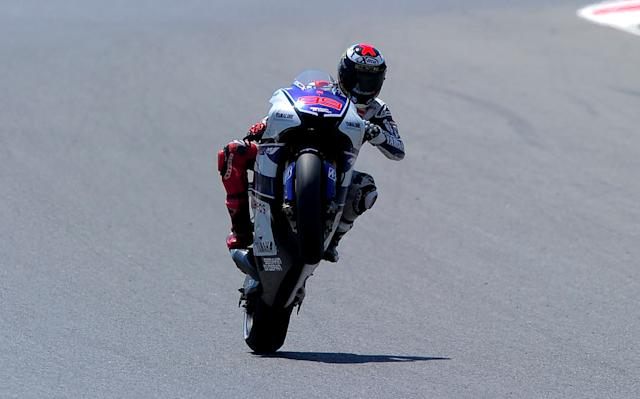 Yamaha Factory Racing's Spanish Jorge Lorenzo makes a wheelie at the Catalunya racetrack in Montmelo, near Barcelona, on June 2, 2012, during the MotoGP qualifying session of the Catalunya Moto GP Grand Prix. AFP PHOTO / JOSEP LAGOJOSEP LAGO/AFP/GettyImages