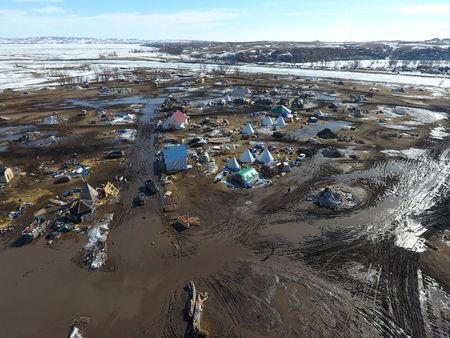 Standing Rock Protesters Hold Leaving Ceremony by Burning Camp