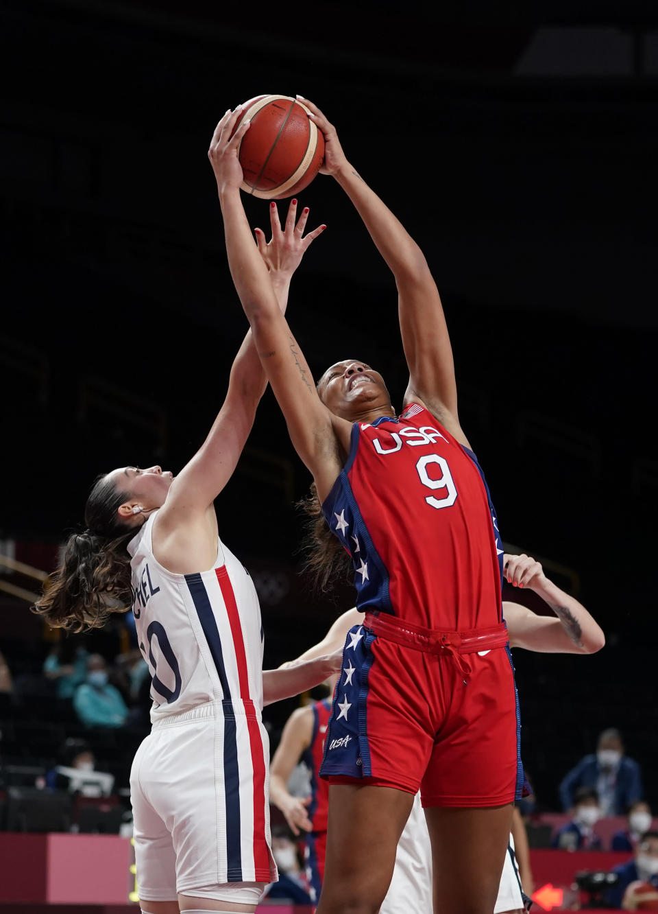 France's Sarah Michel (10), left, and United States' A'Ja Wilson (9) fight for the ball during women's basketball preliminary round game at the 2020 Summer Olympics, Monday, Aug. 2, 2021, in Saitama, Japan. (AP Photo/Charlie Neibergall)