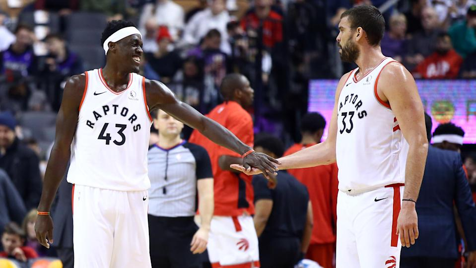 TORONTO, ON - DECEMBER 01:  Pascal Siakam #43 of the Toronto Raptors slaps hands with Marc Gasol #33 during the first half of an NBA game against the Utah Jazz at Scotiabank Arena on December 01, 2019 in Toronto, Canada.  NOTE TO USER: User expressly acknowledges and agrees that, by downloading and or using this photograph, User is consenting to the terms and conditions of the Getty Images License Agreement.  (Photo by Vaughn Ridley/Getty Images)