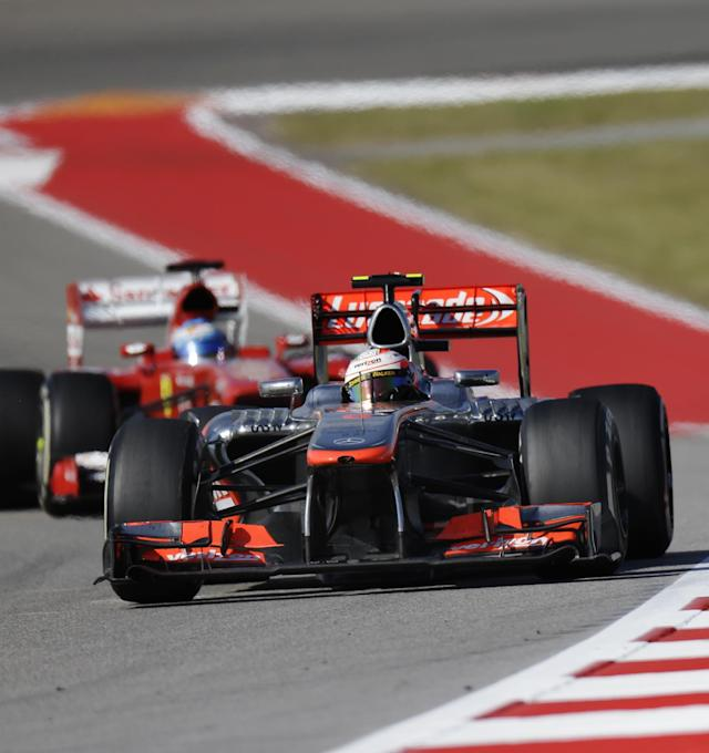 McLaren Mercedes driver Sergio Perez of Mexico leads Ferrari driver Fernando Alonso of Spain during the Formula One U.S. Grand Prix auto race at the Circuit of the Americas, Sunday, Nov. 17, 2013, in Austin, Texas. (AP Photo/David J. Phillip)