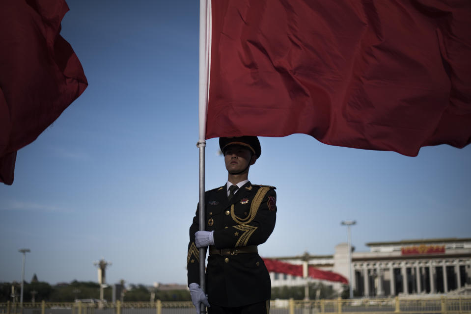 TOPSHOT - A member of a Chinese military honour guard holds a red flag prior to a meeting between Chinese Premier Li Keqiang and New Zealand Prime Minister John Key at the Great Hall of the People in Beijing on April 18, 2016. / AFP / FRED DUFOUR        (Photo credit should read FRED DUFOUR/AFP via Getty Images)