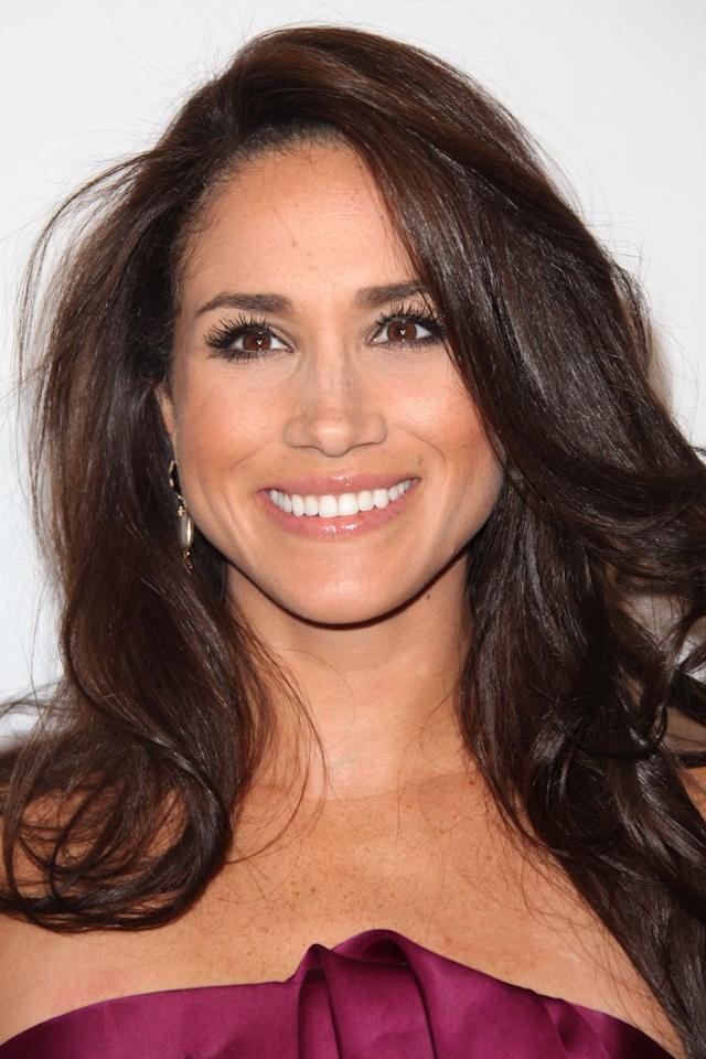 <p>While she was still a star on USA Network's <em>Suits</em>, Markle attended the 2013 ELLE Women in Television celebration and styled her hair with a simple, shiny, and bouncy blowout. <em></em> </p>