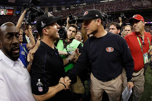 Head coach John Harbaugh of the Baltimore Ravens shakes hands with his brother head coach Jim Harbaugh of the San Francisco 49ers after winning Super Bowl XLVII at the Mercedes-Benz Superdome on February 3, 2013 in New Orleans, Louisiana. The Ravens defeated the 49ers 34-31. (Photo by Ezra Shaw/Getty Images)