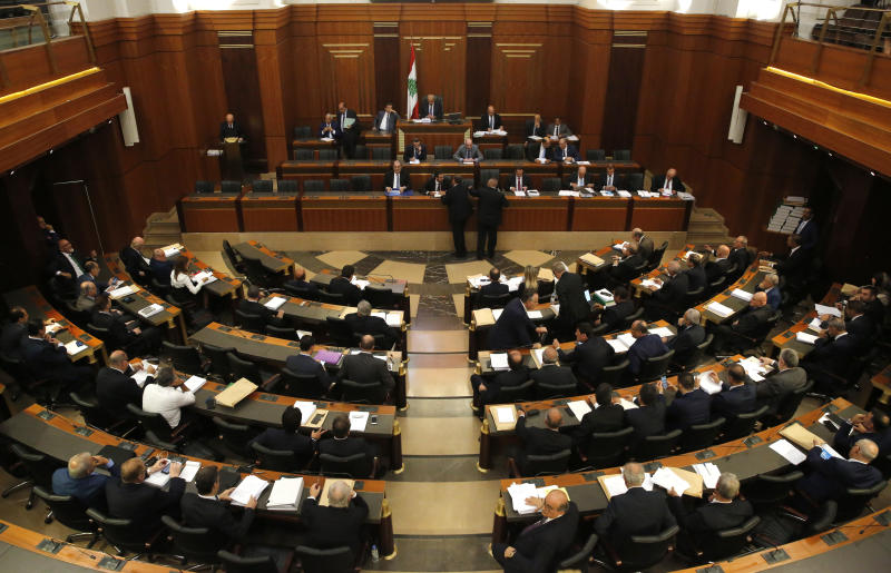 Lebanese lawmakers and ministers meet at the parliament building during the opening session of the draft 2019 state budget, in Beirut, Lebanon, Tuesday, July 16, 2019. Lebanese lawmakers have begun discussing the budget amid tight security and limited protests against proposed austerity measures. The proposed budget aims to avert a financial crisis by raising taxes and cutting public spending in an effort to reduce a ballooning deficit. (AP Photo/Hussein Malla)