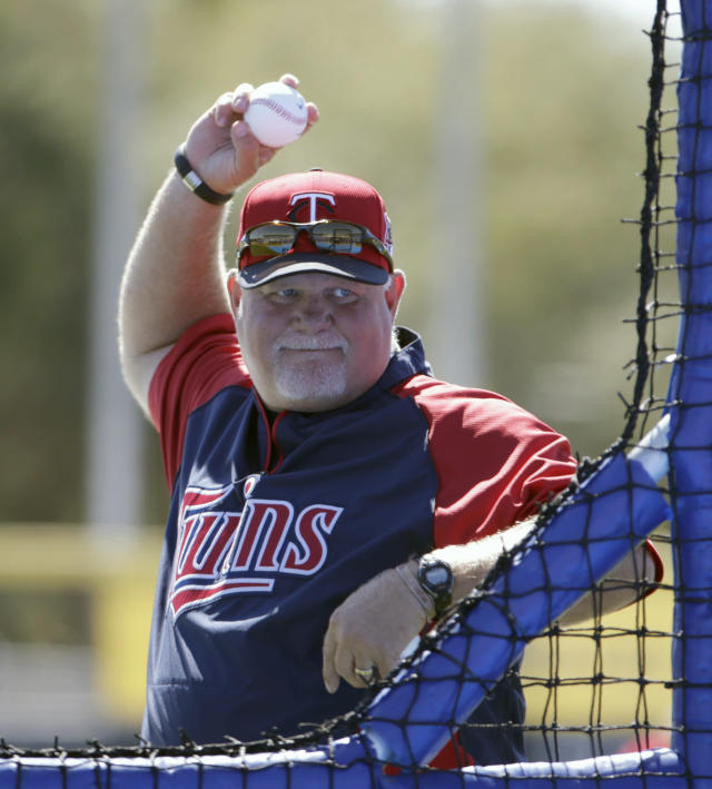 Minnesota Twins manager Ron Gardenhire throws during batting practice to his traveling squad before a spring training baseball game against the Toronto Blue Jays in Dunedin, Fla., Saturday, March 8, 2014. (AP Photo/Kathy Willens)
