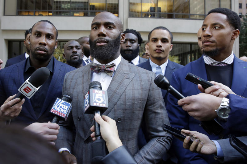On Oct. 17, former NFL football player Anquan Boldin, left, Eagles safety Malcolm Jenkins, center, and 49ers safety Eric Reid, right, speak to the media outside NFL headquarters. (AP)