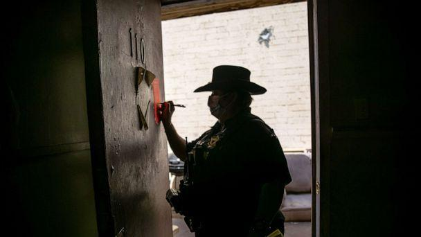 PHOTO: Maricopa County constable Darlene Martinez signs an eviction order, Oct. 7, 2020, in Phoenix. (John Moore/Getty Images, FILE)