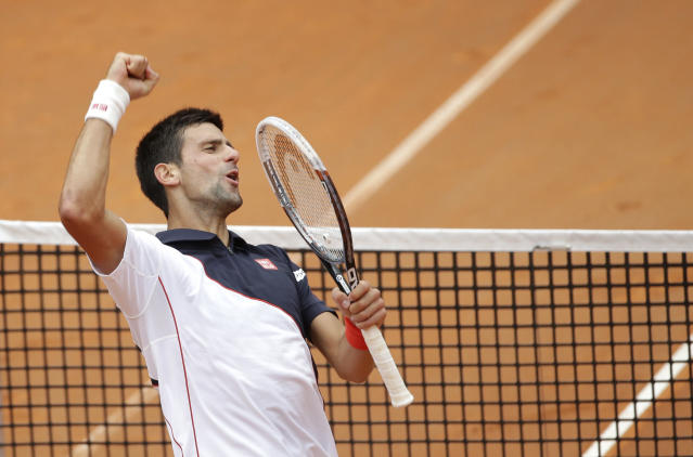 Serbia's Novak Djokovic celebrates after beating Spain's David Ferrer during their quarterfinal match at the Italian Open tennis tournament, in Rome, Friday, May 16, 2014. Novak Djokovic is back on track after a right wrist injury sidelined him last week. The second-ranked Serb overcame a stiff challenge from David Ferrer before grinding out a 7-5, 4-6, 6-3 win Friday to reach the Italian Open semifinals. (AP Photo/Alessandra Tarantino)